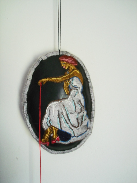 wool and thread embroidery on rubber