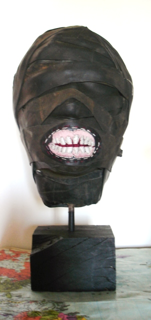 medium: cement fondue, rubber/inner-tube, embroidery, steel, wood