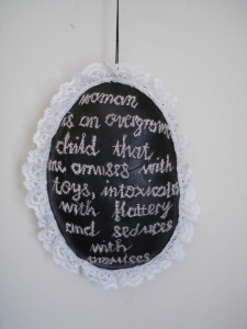 Woman is....(Embroidery on rubber) 2013