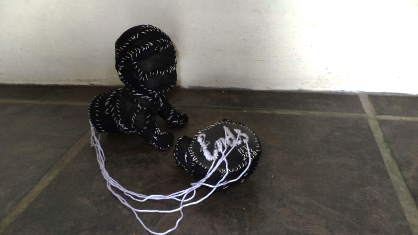 """Loose ends"".  Found object, cloth, thread and embroidery on rubber"
