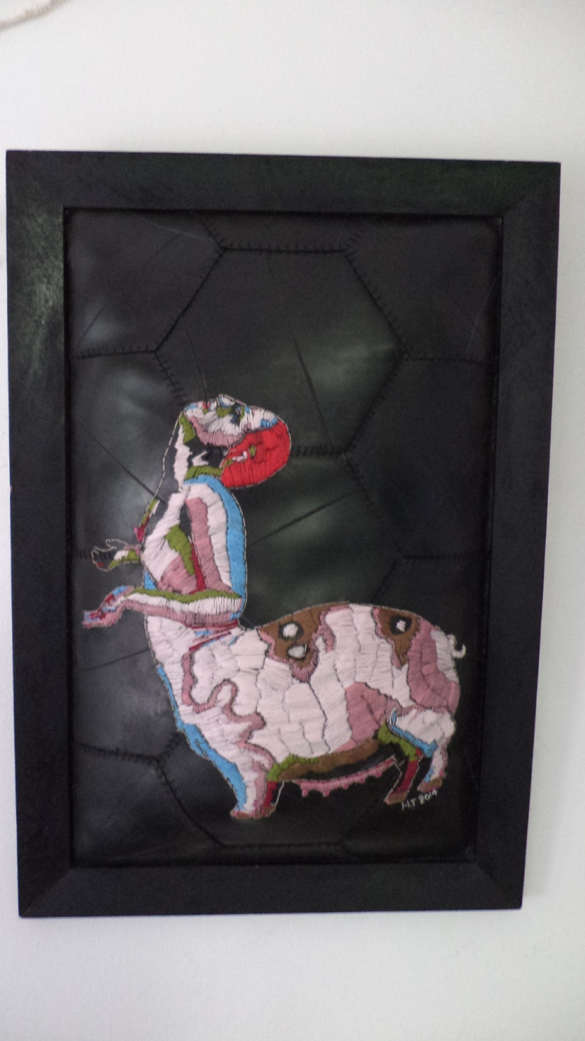 """Wie is die vark in die verhaal? embroidery on rubber/inner tube. 2014 (67 x 46 cm)"
