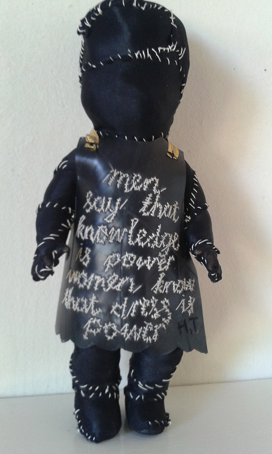 """Dress is power"" cloth, thread, found object, embroidery on rubber (work in progress)"