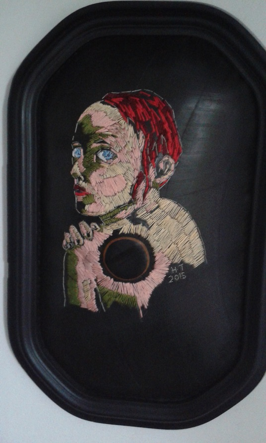 """All she needs is a pat(ch) on the back"" Cotton thread, rubber, batting and vintage frame. 2015"