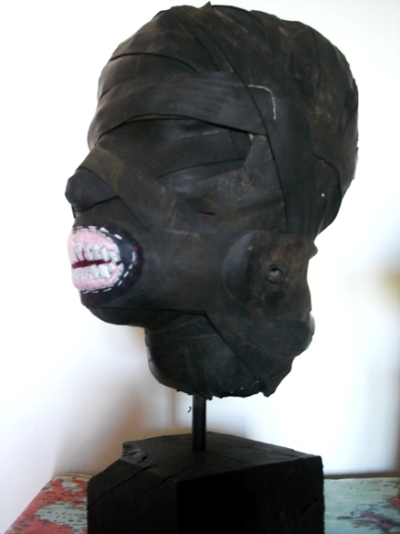 Title: Self-portrait (bust) Medium: cement fondue, steel, wood, cotton thread and rubber