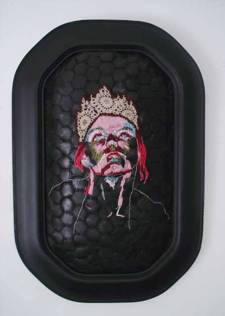 Title: Rubber, rubber on the wall, who is the toughest of them all? Medium: cotton thread, batting and rubber, wood (framed)